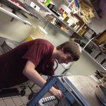 Luke putting pans away